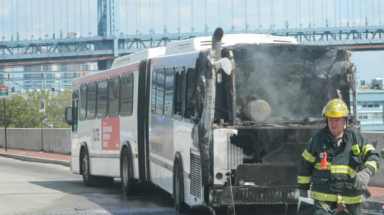 Fire fighters battle a blaze after a SEPTA bus caught fire in Old City.