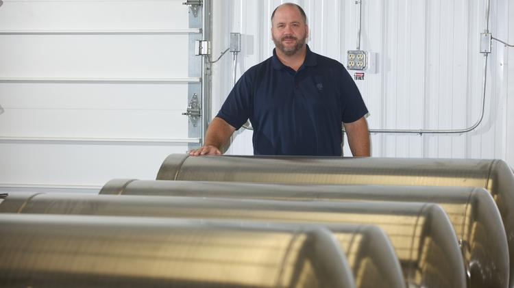 Peter Coleman shows off tanks manufactured by Green Buffalo Fuel in Tonawanda that are used nationwide for liquefied natural gas applications.