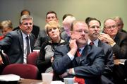 City Manager Ron Carlee, backed by city staffers, listens intently to Bob Hazel's presentation.