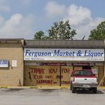 Which businesses have committed to reopening in Ferguson?