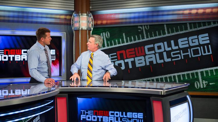 Tommy Bowden, right, on the set of The New College Football Show with host James Bates.