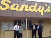 Gov. Rick Perry enjoys an ice cream cone at Sandy's after being booked at the Travis County Courthouse Tuesday.