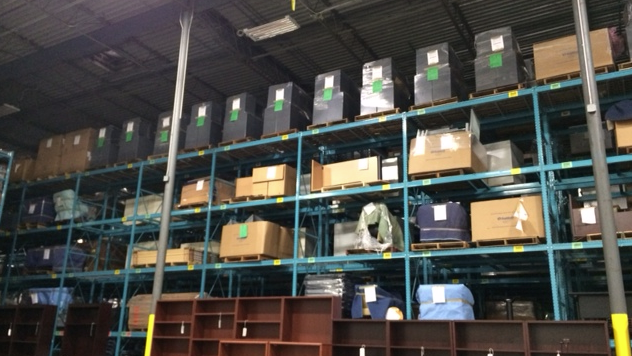 The facility has floor to ceiling boxes of remanufactured office furniture.