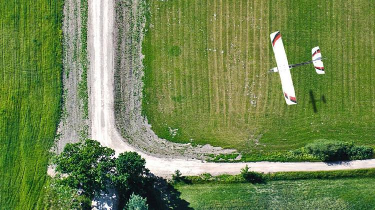 The Lancaster, a drone developed by PrecisionHawk, flying over a field.