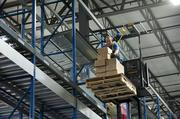 A UPS Supply Chain Solutions employee is shown stacking boxes at the operation's facility near Outer Loop. The business might develop warehouses at Renaissance South Business Park.