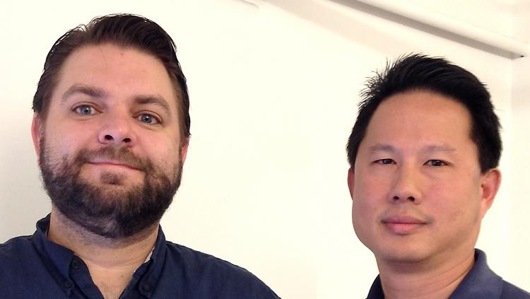 President Rex Chu, right, and production manager Matthew Welsh have revamped commercial printing company Texas Litho.