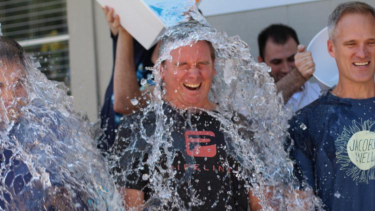 EyeVerify CEO Toby Rush takes a bucket of ice water over the head Wednesday after his startup landed $6 million in funds from a variety of investors.