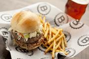 The Porky burger features Carolina-style vinegar bbq pulled pork, cole slaw, cleveland bbq sauce and bacon.