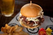 The Fat Doug burger comes with cole slaw, pastrami, Swiss and mustard.