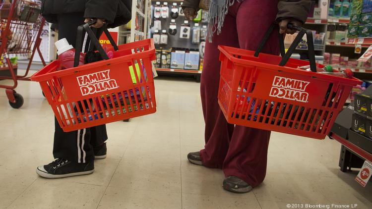 Shoppers wait in line at a Family Dollar store.