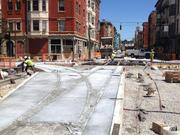 Now that the rail for the 12th and Race diamond has been installed, crews are pouring concrete to get the intersection ready to open on Aug. 23.