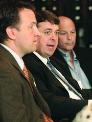 Padraic McGrath, center, of Limbach Facility Services LLC, is flanked by Cory Dieble, left, of P.J. Dick Inc. and Dennis McKamish of McKamish Inc.