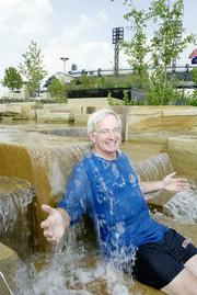 Tom Murphy poses in a newly opened fountain at the North Shore Riverfront Park in 2002. The park was part of a $200 million development project  between the two stadiums.