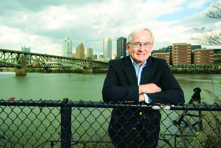 Former Pittsburgh Mayor Tom Murphy poses for a photograph along the banks of the Monongahela River.