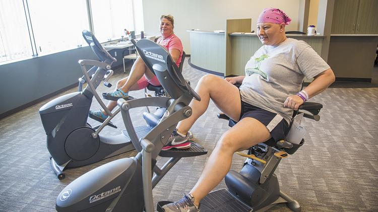 Vickie Lovell, left, and her daughter, Angela Brady, work out together at a Kentucky One Healthy Lifestyle Center.