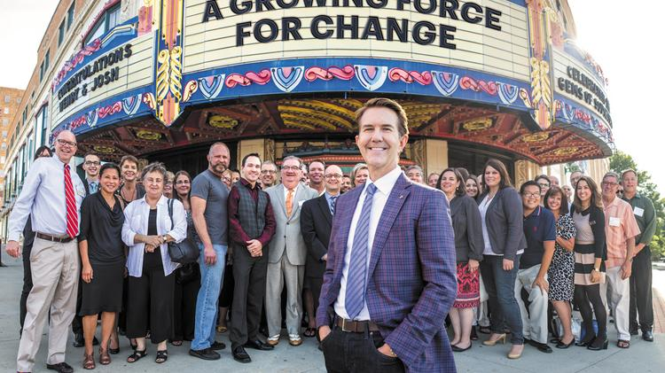 Dan Nilsen (foreground), CEO of Bishop McCann and founder of the Mid-America Gay & Lesbian Chamber of Commerce, attends a networking event with LGBT colleagues at the Uptown Theater.