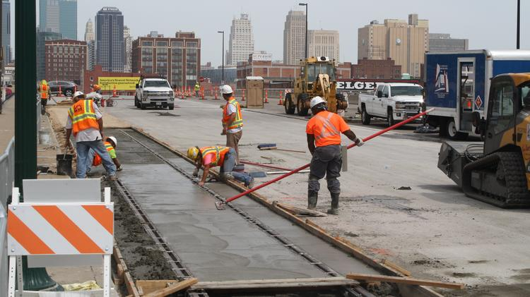Contractors for joint venture KC Streetcar Constructor lay concrete around streetcar tracks laid in the Main Street bridge north of Pershing Road earlier in August. Track work on that bridge will continue through September.