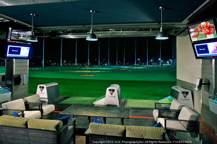 TopGolf's luxury entertainment complexes, like this one in Houston, include three-story driving ranges, restaurants and private event spaces.