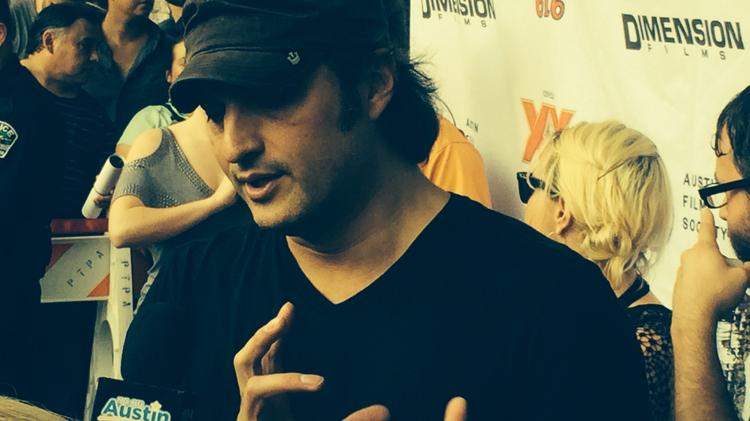 "Robert Rodriguez, who co-directed Sin City along with artist Frank Miller, who created the Sin City graphic novels, speaks to reporters before the Austin premiere of ""Sin City: A Dame to Kill For"" on Aug. 20."