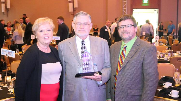 Dr. John Post (center), medical director of the McDowell Healthcare Center, was named this year's Lifetime Achievement Winner. Click through for more photos from the event.