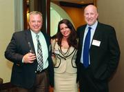 Rich Carver, left, Domenica Ferraro and Joe Wells, all of System One Services.