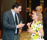 Bill Summers of Vision Finance Group and Kelly Carlson of Huntington Bank.PHOTO