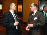 Bill Lucas, left, of Junior Achievement of Western Pennsylvania, and Gene Pietrowski of L.R. Kimball.