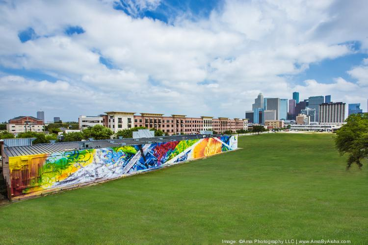 Click through the slideshow to see some of the developments that have recently sprouted in the Midtown area. Some opened this year, and some are on their way.   Pictured: Houston's largest full-scale mural in Midtown, completed by artists from Eyeful Art in April. The art was intended to be an abstract representation of Houston Midtown's logo.