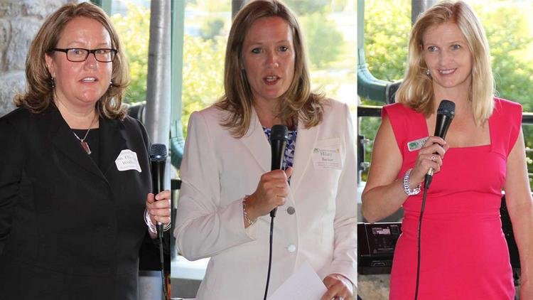 Left to right: The Hon. Elizabeth Wolford, who eight months ago became the first female federal judge in the region, received the President's Award; Hilary Banker is the 2014 recipient of the M. Dolores Denman Lady Justice Award, formerly known as the Achievement Award; Laura Linneball is the 30th president of the local chapter of the Women's Bar Association.