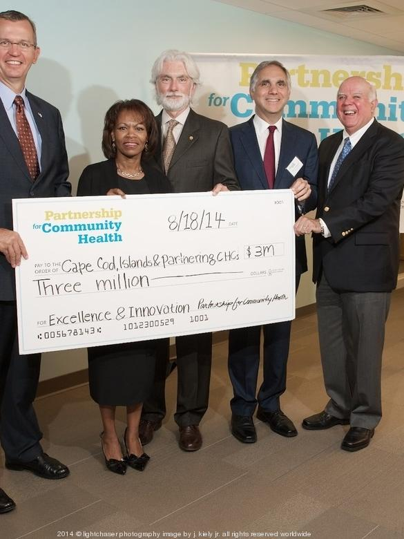 Neighborhood Health Plan, Partners HealthCare and the Massachusetts League of Community Health Centers gathered Monday morning at Harbor Community Health Center - Hyannis to announce the most recent round of grants. (From left) Secretary of Health and Human Services John Polanowicz; President and CEO of Neighborhood Health Plan Deborah Enos; Daniel Driscoll, president and CEO of Harbor Health Services; Gary Gottlieb, president and CEO of Partners HealthCare; and James Hunt, president and CEO of Massachusetts League of Community Health Centers pose at the Partnership for Community Health's Excellence and Innovation grant award event.