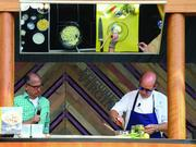 Chef Todd Gray, left, during a demonstration at Epicurience Virginia in 2013.