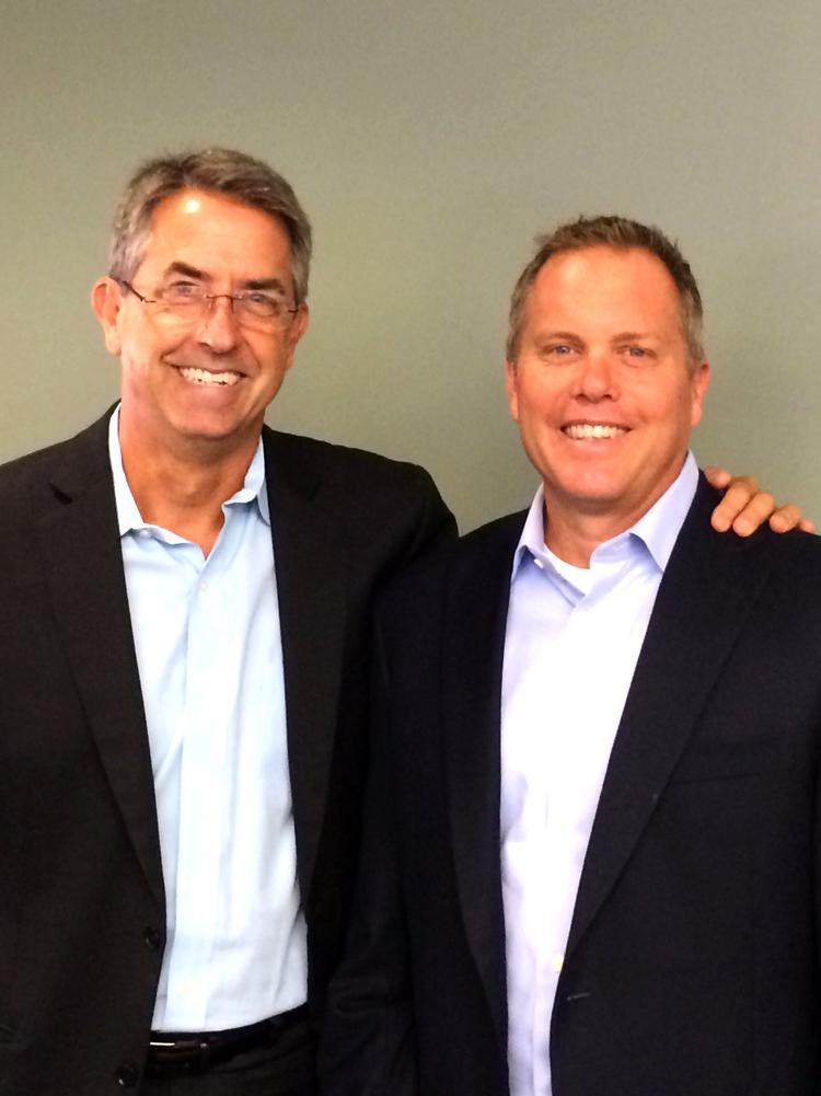 Covered California executive director Peter Lee poses with Kirk Whelan, who has been chosen as director of the Individual and Small Business Sales Division.