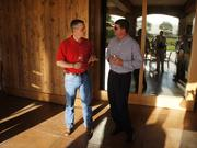 Silver Oak Winery President and CEO David Duncan visits with Craig Anderson of UMB. The winery, damaged Aug. 24 in an earthquake, was one of several wineries visited by the 2012 Best in Business group.