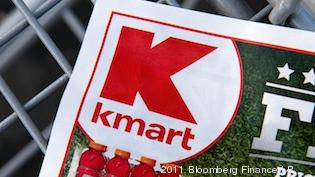 A Kmart advertisement sits in the bottom of a shopping cart in December, after Sears Holdings Corp. said it will close as many as 120 Sears and Kmart stores.