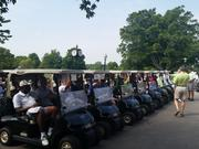 "Carts full of golfers prepare to start on the course at the ""Just Fore Kids"" Golf Classic Monday at Hurstbourne Country Club."