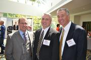 Jon Eller, from left, of Davis Construction, Mike Etherton of MGAC, and Jim Davis of Davis Construction.