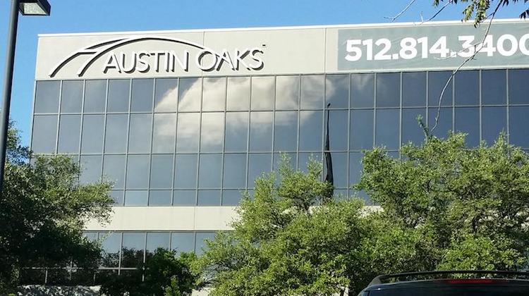 The Austin Oaks signature building at Spicewood Springs Road and North Mopac Expressway would be replaced by a much taller building, if a rezoning is approved.