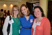 From Acuity, No. 17 on the list of medium-sized companies, Katie Veatch, from left, Joy Gately, and Jannie Gardner.