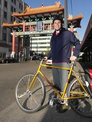 """Josh King, general counsel of Avvo Inc., commutes from Capitol Hill to his office in in the International District. For King, awareness is the key when bike commuting. He said he will often """"take the lane"""" when commuting because it's safer than being in the door zone of parked cars."""