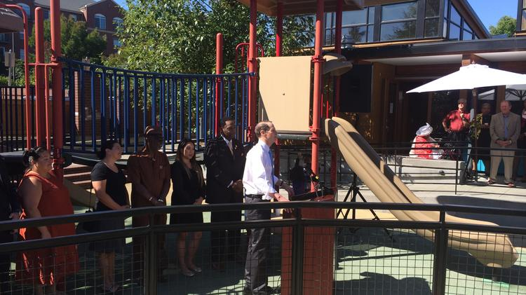 Sen. Ron Wyden (in the middle) appeared at the announcement this morning that Albina Head Start would receive $18 million in New Market Tax Credits.