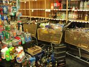 Bottles waiting to be cleaned and re-shelved in Val's Liquors in Napa.