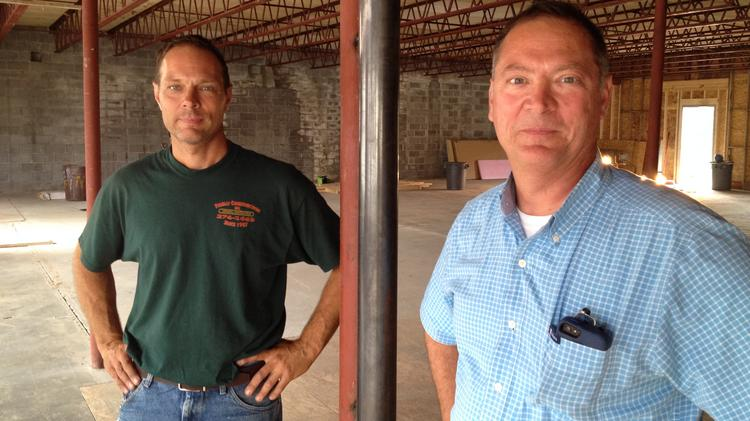 Mark Finelli, left, and his brother John Finelli inside their latest real estate investment in Troy, New York -- an abandoned building at 362-364 Congress St. that will be the new home of a Dunkin Donuts commercial bakery and other tenants.