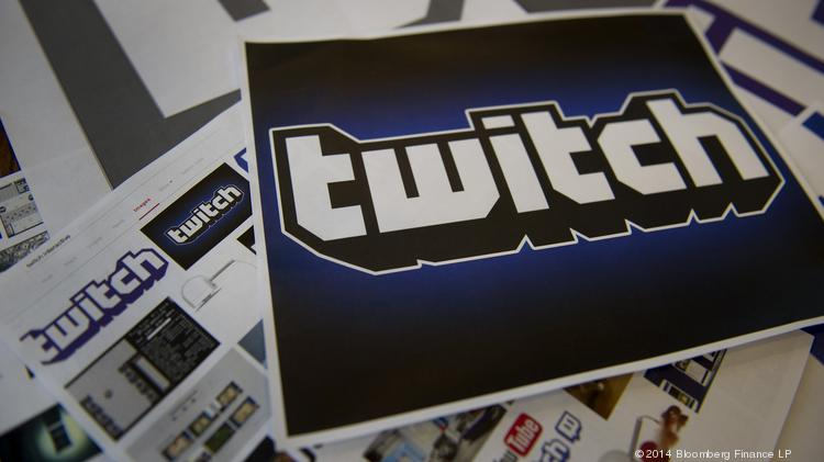 The Twitch Interactive Inc. logo is arranged for a photograph in San Francisco, California, U.S., on Monday, Aug. 25, 2014. Amazon.com Inc. is buying video service Twitch Interactive Inc. for nearly $1 billion in its biggest acquisition ever, adding an online gathering place for video gamers, people with knowledge of the plans said. Photographer: David Paul Morris/Bloomberg