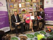 Cindy McCain, Roberto Llamas, executive vice president, chief human resources & community empowerment officer, Univision Communications; and Enrique Acevedo, co-anchor Univision News, read to children during roundtable for the Too Small to Fail (Pequeños y Valiosos) Phoenix Community Event.