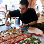 Pizza cut with scissors? It might sound strange, but Pizzeria Gabbiano is a big hit in Pioneer Square