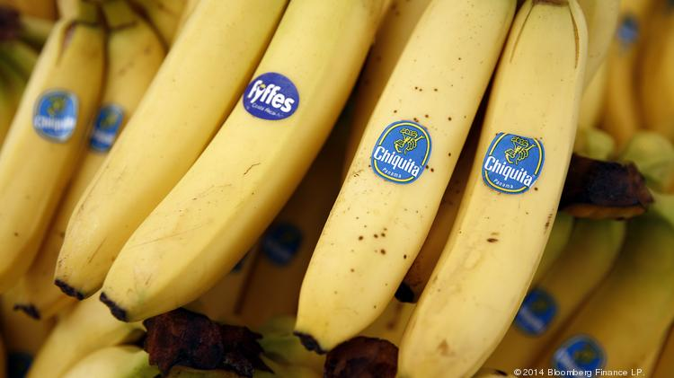 A bunch of Fyffes bananas, grown by Fyffes Plc, left, sits with bunches of Chiquita bananas, grown by Chiquita Brands International Inc., in this arranged photograph.