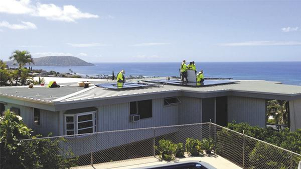 Hawaii Energy Connection workers install a photovoltaic system at a Waialae Iki home. Managing Partner Chris DeBone says the company is installing up to a dozen systems a day.