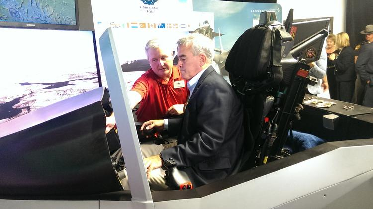 U.S. Rep. Brad Wenstrup tests the F-35 cockpit simulator at GKN Aerospace on Wednesday.