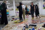 Kindering Center fundraiser guests don old shoes, dip their shoes in paint and dance on a large canvas to the sounds of a jazz band. Kindering Center fundraiser guests don old shoes, dip their shoes in paint and dance on a large canvas to the sounds of a jazz band.