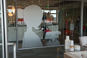 A silhouette of a receptionists at the entrance to Ruby Receptionists new Beaverton offices.